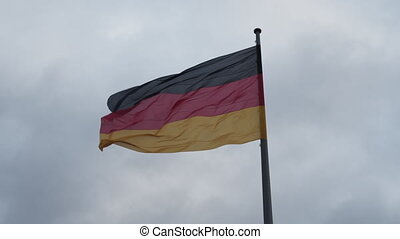 SLOW MOTION: Close up of beautiful German Flag waving in the Wind with Overcast