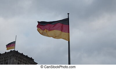 SLOW MOTION: Close up of German Flag waving in the Wind with Overcast