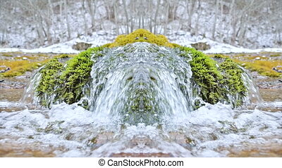 Slow motion close-up of the mountain river in the winter next to the snow and green moss. Kaleidoscope effect psychedelic reflection. Natural clean water abstraction