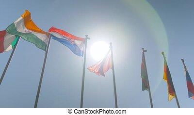 Slow motion - colorful flags fluttering in the wind - politics concept