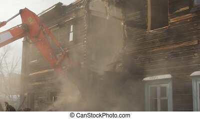 Slow motion. Demolition of dilapidated old house. Rundown building