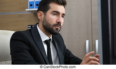 Depressed entrepreneur in his office exhales and puts his hed in hands