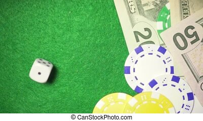 Slow motion dice roll on chips and money casino