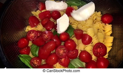 Slow Motion Dropping Mozzarella On Pasta And Tomato. At the...
