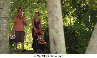 Slow Motion Family Father Mother Daughter Baby In Park
