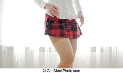 Slow motion footage of beautiful slim girl in school uniform...