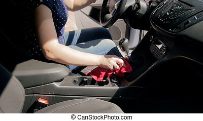 Slow motion footage of female driver polishing and cleaning...