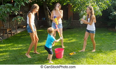 Slow motion footage of happy cheerful family having fun in...