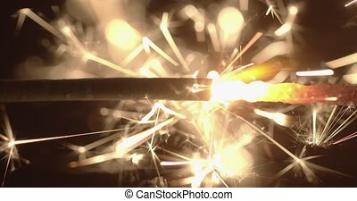 Slow motion footage of sparkler in the dark
