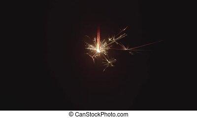 Slow motion footage of sparkler in the dark