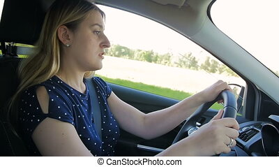 Slow motion footage of young woman feeling very tired and...
