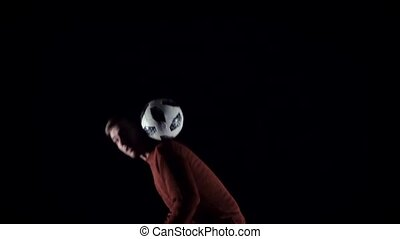 Slow motion, football player making tricks with ball on...