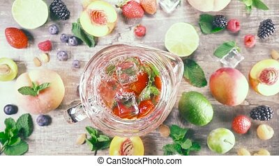 Slow motion fruit drink with ice top view