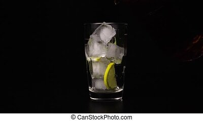 Slow motion glass with ice and lemon