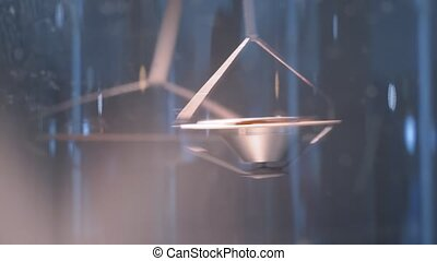 Slow motion: hanging metal gyroscope spinning top pendulum - interactive exposition at science exhibition museum - close up. Physics, experiment, education, laboratory equipment concept