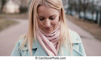 Slow motion happy Caucasian girl using smartphone. Cute...