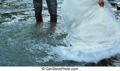 Slow motion. Happy couple in love have a joy during walk near river. 100fps
