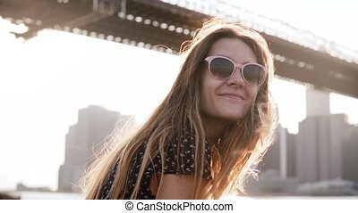 Slow motion happy girl in sunglasses with amazing golden...