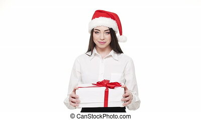 Slow motion happy young business woman giving parcel Christmas box to camera.