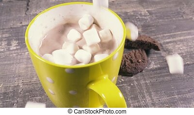 Slow motion hot chocolate in a mug and marshmallow