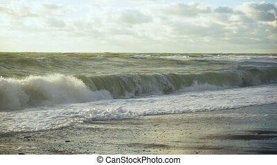 Slow motion in the stormy ocean the wave beats against the...