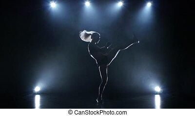 Slow motion in the studio. Training girl boxer kicking jump