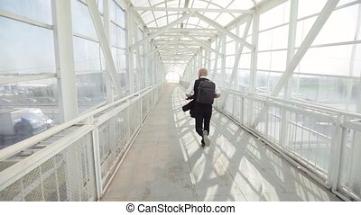SLOW MOTION: Late businessman is running to a meeting - slow...