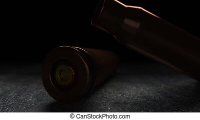 Slow motion macro animation of falling smoking gun...