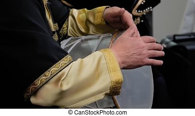 Slow motion: man hands playing ethnic azerbaijani percussion drum nagara on stage of summer open air concert - close up view. Entertainment, music, culture, leisure time and art concept
