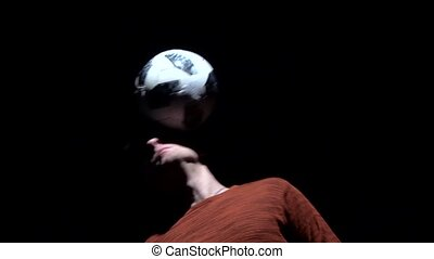 Slow motion, man making tricks with ball on head. Close-up