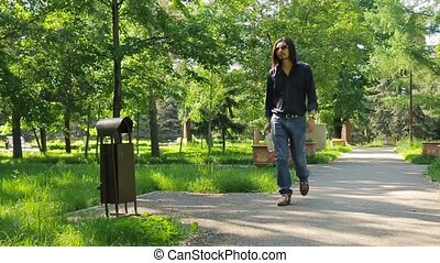 Slow motion man misses and walks away when throwing out plastic bottle in the waste urn Environmental problem