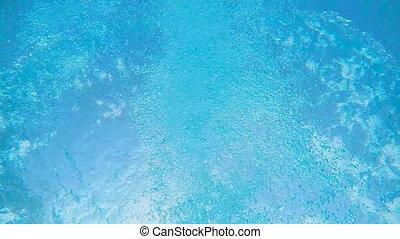 SLOW MOTION: Man swimming in hotel pool underwater shot