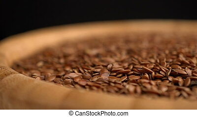 many flax seeds rotating background - Slow motion many flax...