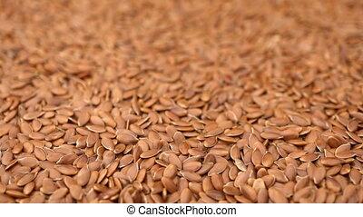 many flax seeds rotating background - Slow motion many flax...