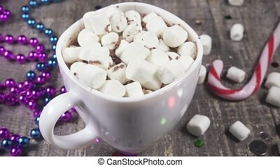 Slow motion marshmallow in a mug with a drink sprinkle with...