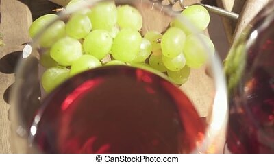 Slow motion movement of the camera over a table with wine...