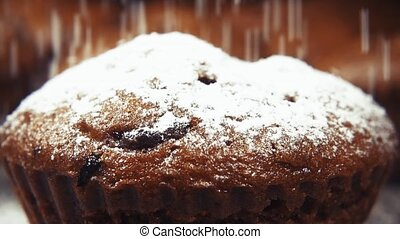 Slow motion muffins sprinkle with powdered sugar close up -...