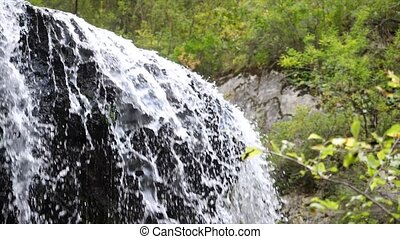 Slow motion natural beauty waterfall, view of nature.