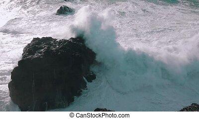 Slow Motion Ocean Waves Breaking on Rocks