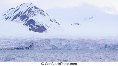 Slow motion of a massive glacier in the cold arctic -...