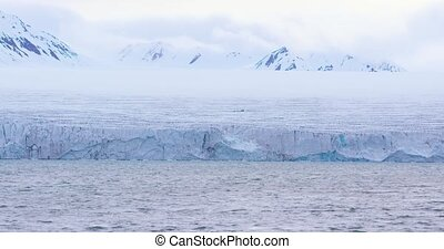 Slow motion of a massive glacier in the arctic - Close-up of...