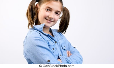 Slow motion of beautiful teenager girl smiling at the camera