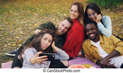 Slow motion of beautiful young people hipsters taking selfie...