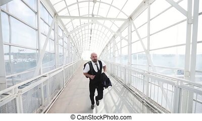 slow motion of business man traveler running in hurry in the...