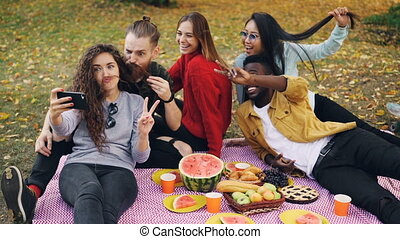 Slow motion of carefree girls and guys multiethnic group...