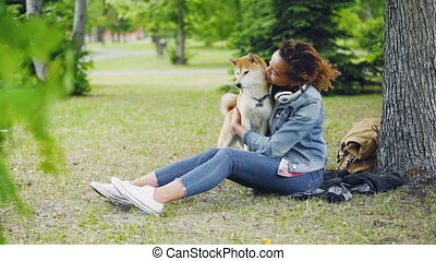 Slow motion of cheerful girl happy pet owner caressing,...