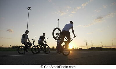 Slow motion of cool biker riding his bicycle using front...