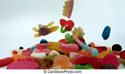 Slow motion of falling jelly sweets - Extreme slow motion of...