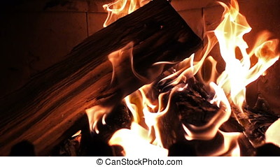 Slow motion of flames surrounding log