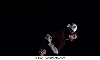 Slow motion of football player making tricks with ball....